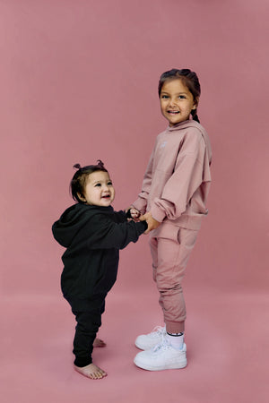 black oversized sweatsuit for kids, children and baby. Best streetwear hoody and jogger co-ord set for kids.