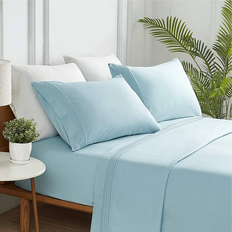 Light blue sheets on comfortable bed / Moisture-Wicking Sheet Set from Bedsure