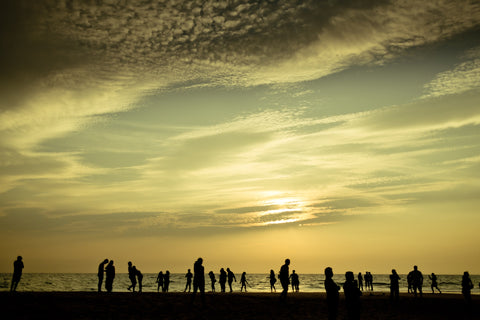 Climate change effects / hottest temperatures / People on beach on hot day / Photo by Raimond Klavins on Unsplash