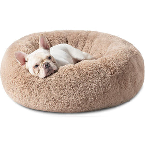 dog in the Bedsure Calming Bed for Dogs - Washable Round Dog Bed --Slip Faux Fur Donut Cuddler Cat Bed