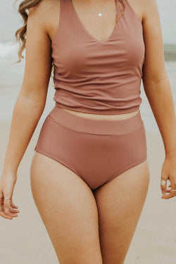 Mauve high waisted, modest bikini bottoms.