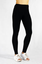 Load image into Gallery viewer, Running Leggings in black with side and pack pocket and natural rubber elastic for optimal hold and stability front view