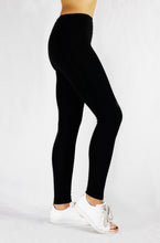 Load image into Gallery viewer, Running Leggings in black with side and pack pocket and natural rubber elastic for optimal hold and stability side view