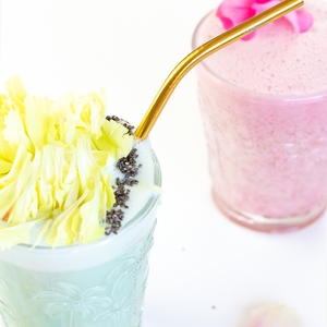 Healthy pink smoothie with bend gold stainless steel straw