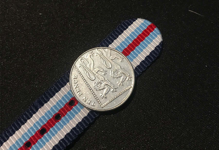 use coin to line up with NATO strap