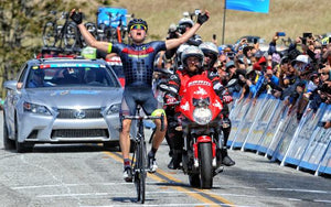 bike racer wins victory pose finish line