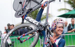 Female bike racer wins time trial victory salute