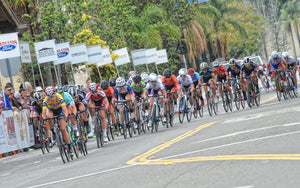 women bike racers ride in group california