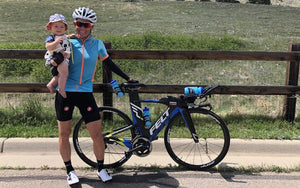 woman bike racer with child triathlon baby