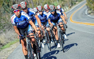 female bike racing team on road
