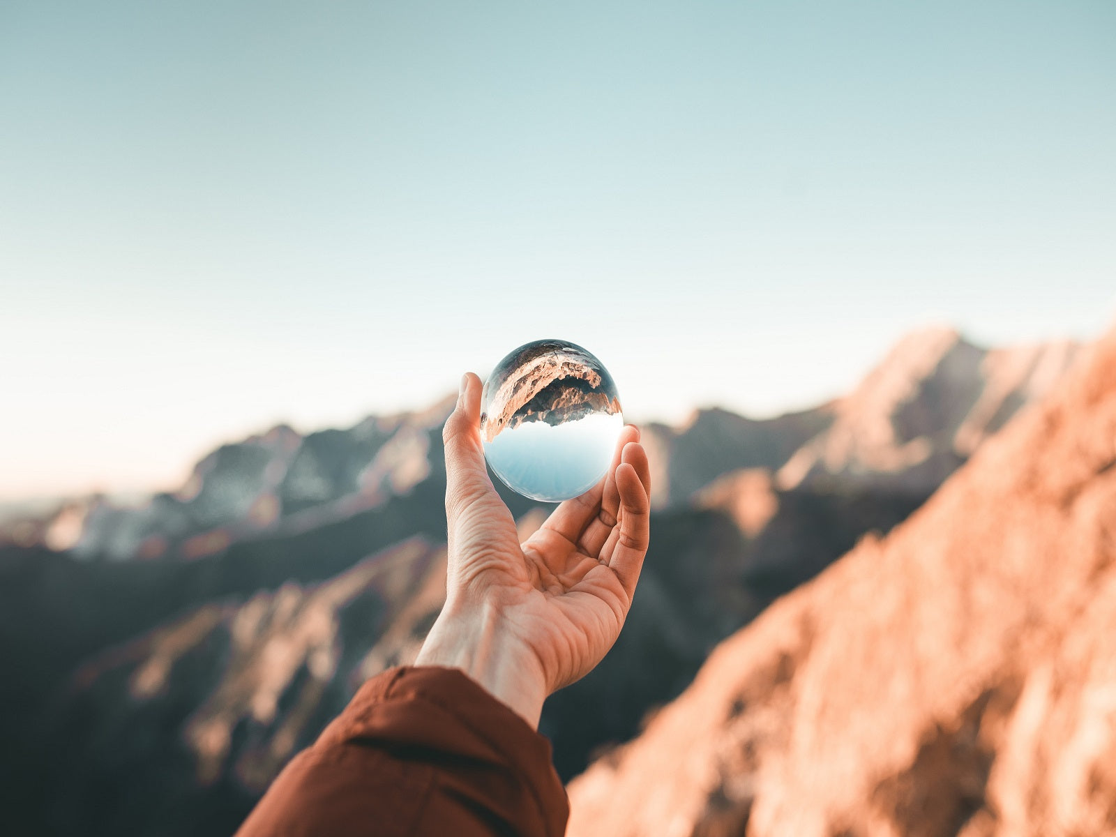 looking at a mountain view through transparent globe