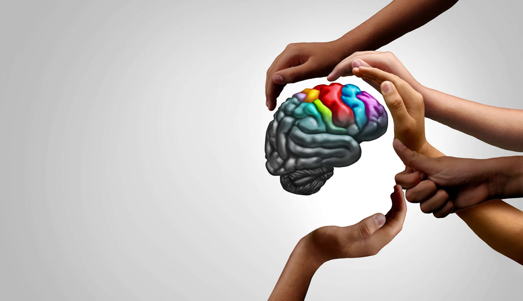 children holding colorful brain depicting effects of autism
