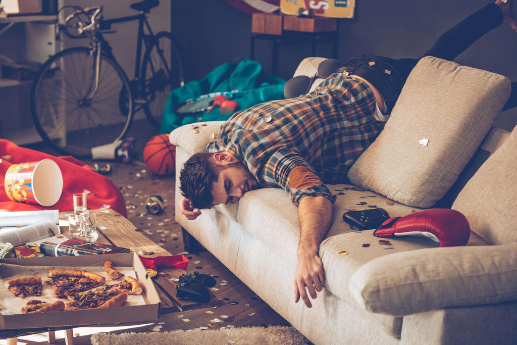 man passed out from drinking too much alcohol