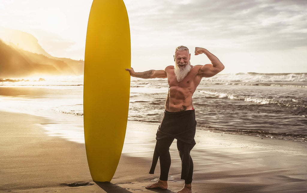 fit senior with a surfboard
