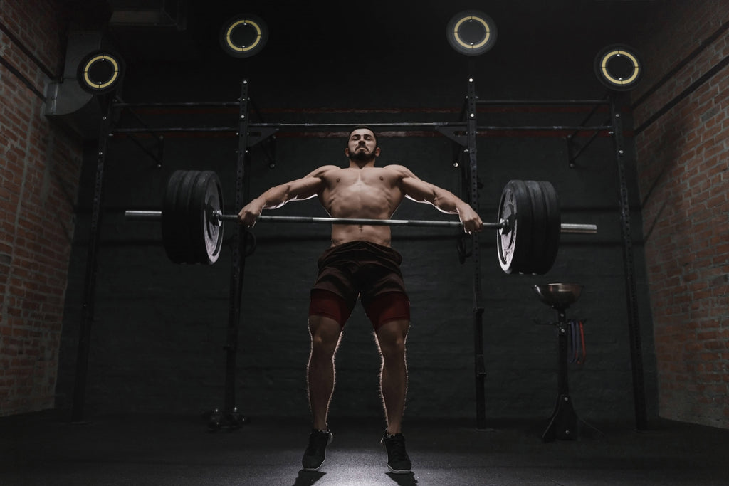 man power lifting weights showing the effects of cbd