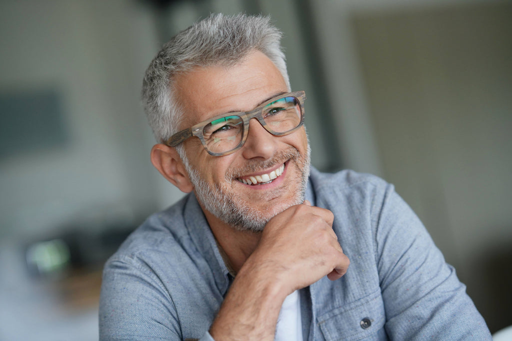 older man smiling depicting the benefits of cbd for pain relief