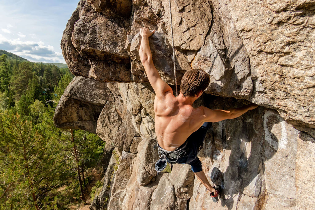 mountain climber hanging from a cliff