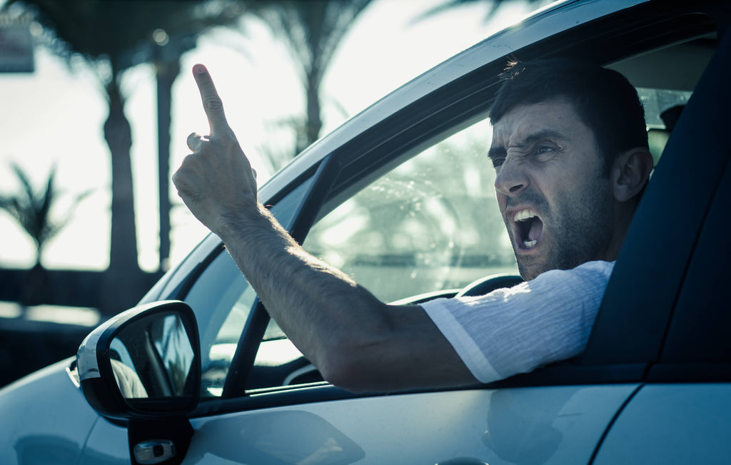angry man showing signs of road rage