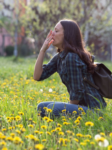 woman with pollen allergy depicting the need for cbd