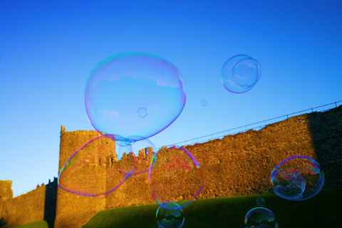 Conwy Castle and giant bubble, setting sun, blue skies, taken at Conwy Food Festival