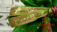 Green vintage silk bag with pink lining and silk tassels.