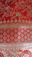 Red banarsi silk long potli bag with rectangular bead trim