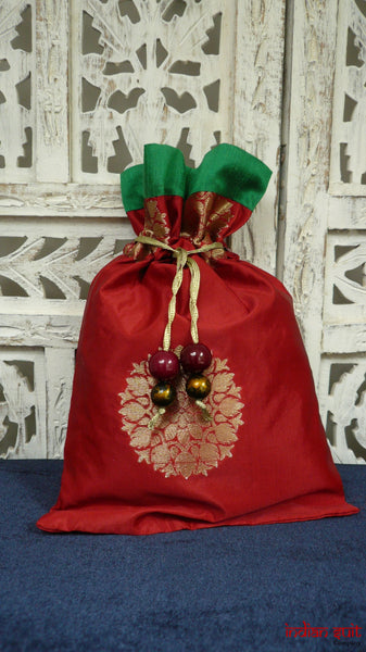 Red silk potli bag with green silk lining