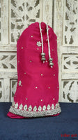 Pink silk with silver work potli bag