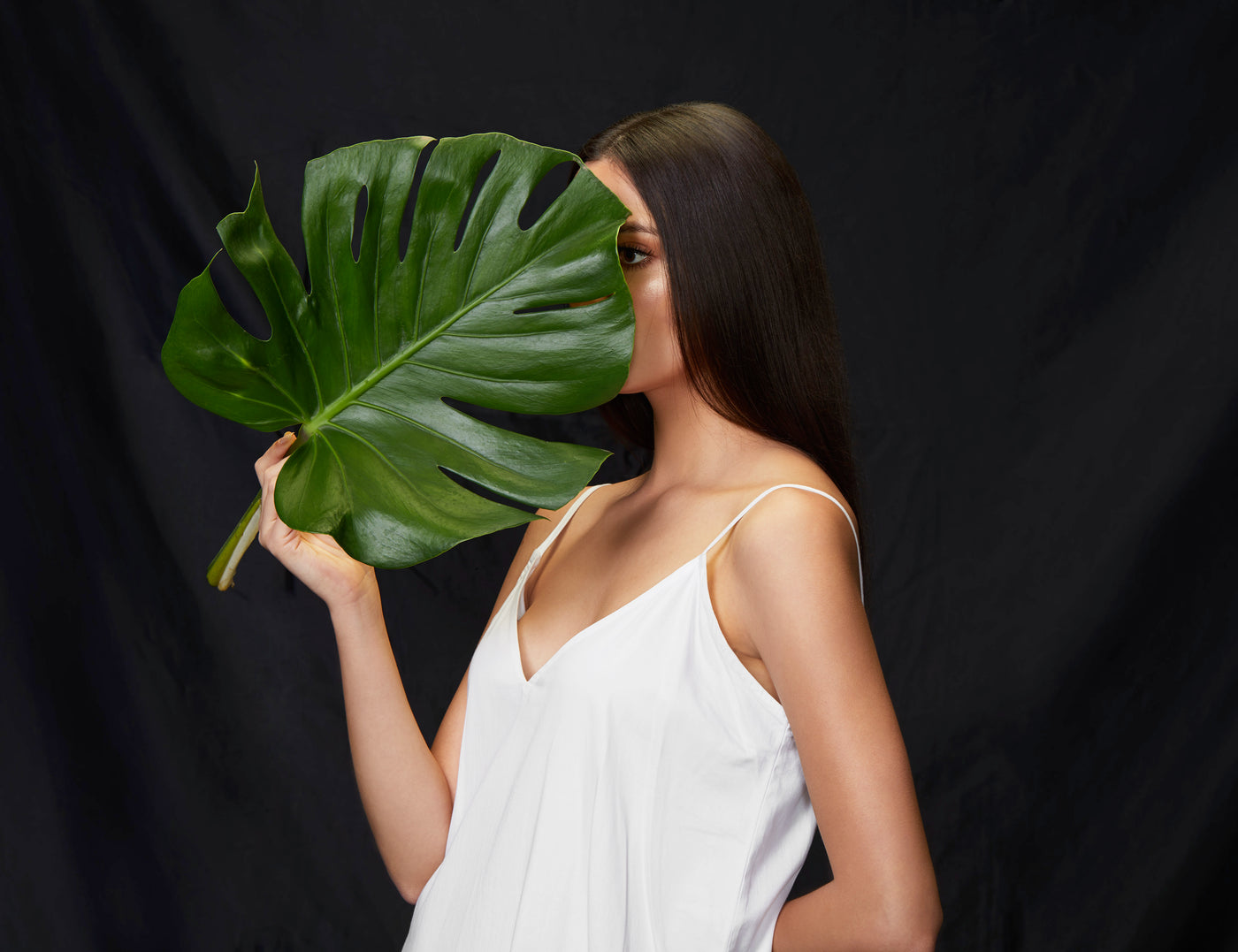 White Shift Dress with model holding leaf