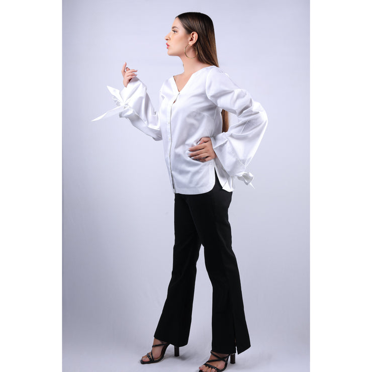 Side View Of Nadine Double Bow White Top With V Neckline And Full Sleeves