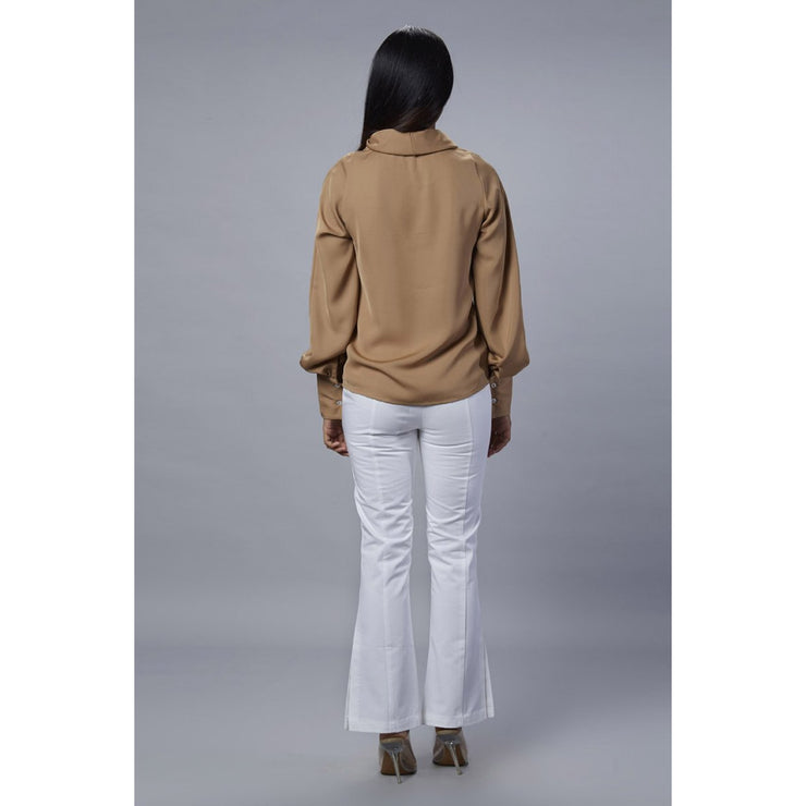 Colette beige cowl neck top Back view with white pant.