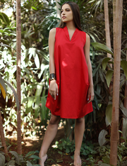 Front view of Katya double pocket red dress in the garden