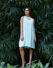 Front View Of Tiara Mint Sun Dress in the garden