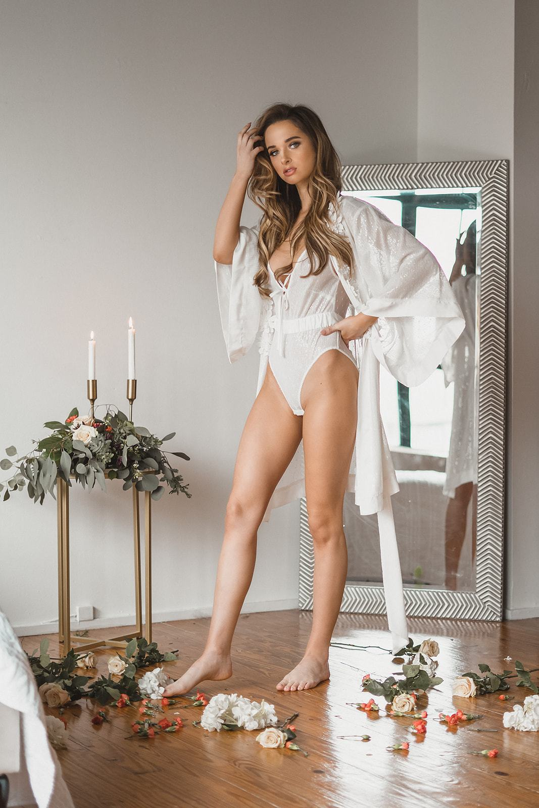 model wearing robe white from sequin fabric