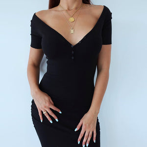 Ankle-Length Knitted Dress With A Wide Neckline.