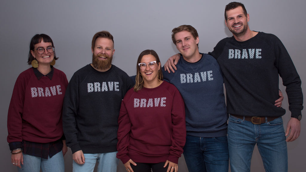 mental health advocates posing in brave sweaters for you are collectives new you are collection