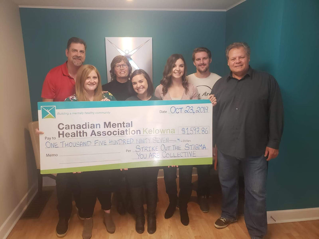 You Are Collective presenting a cheque from strike out the stigma to canadian mental health association