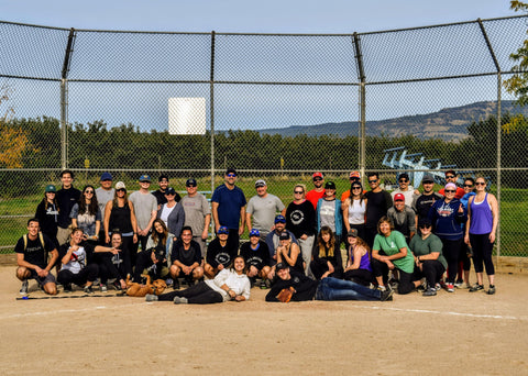 group photo of charities in kelowna at the gold medal game for you are collective's strike out the stigma