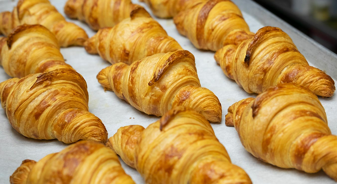 A tray of freshly baked croissants from Total Donut Solutions. Photo Credit: Christina Arsenault