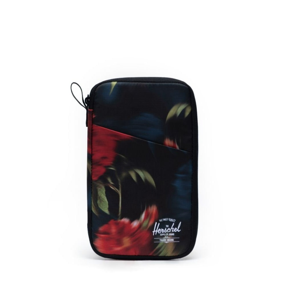 HERSCHEL - TRAVEL WALLET IN BLURRY ROSES