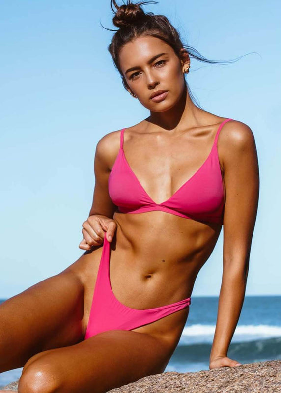 woman wearing pink brazilian bikini