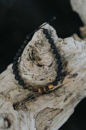 Lava stone bracelet with Tiger's eye stone in the middle