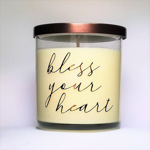 Bless Your Heart candle, honeysuckle and jasmine scented soy candle. Glass jar, bronze lid, front view of candle.