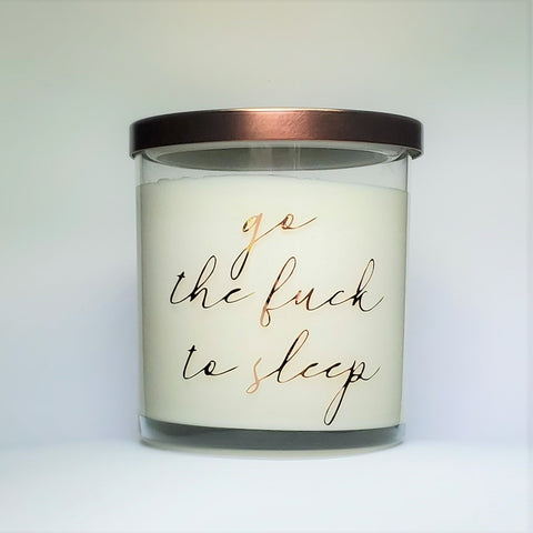 Go the Fuck to Sleep Candle, lavender scented soy wax candle in glass jar with bronze lid, front view.