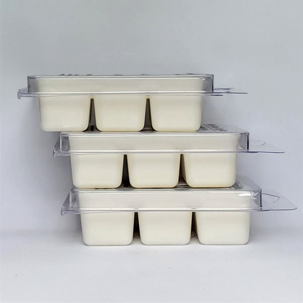 Basic Bitch soy wax melts, vanilla scented, stacked view. Recyclable plastic clamshell containers with 6 cells. 3oz scented wax melts for home fragrance.