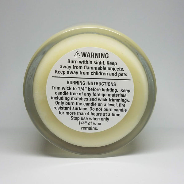 Hoes before bros candle, raspberry vanilla scented soy candle in glass jar with bronze lid, bottom view with warning label. Galentine's present.
