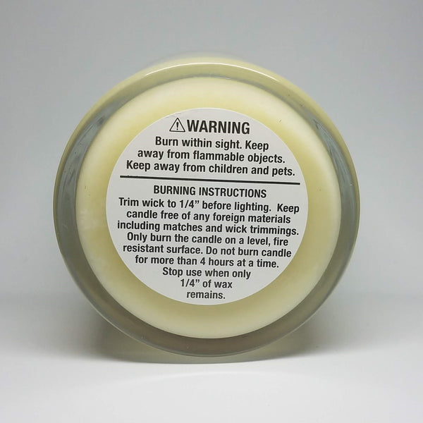 Custom candle, bottom view with warning label. Customizable labels and scents.