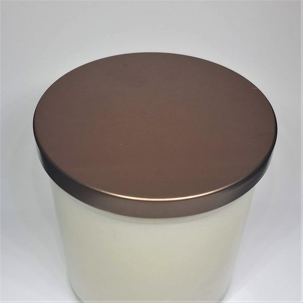 Oh shit candle, odor eliminator candle for bathrooms. Glass jar, bronze lid, bottom view.