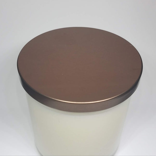 Custom candle, top view with bronze lid. Customizable labels and scents.