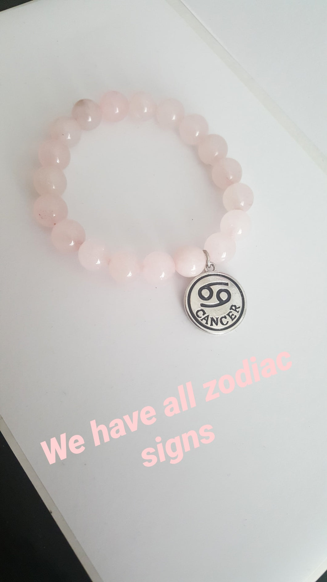 Rose quartz with zodiac charm